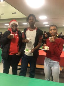 3 students at holiday party with cookies